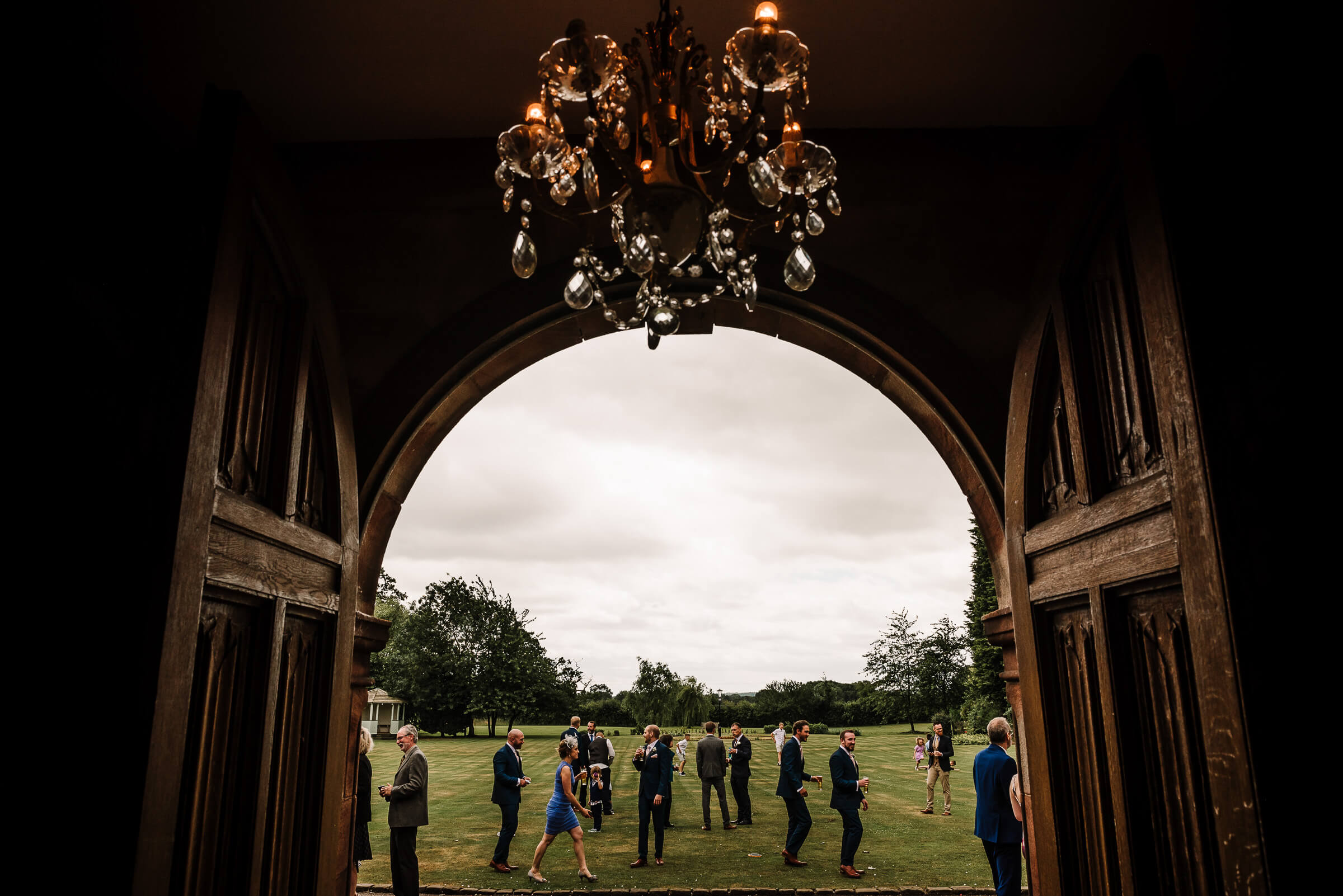 wedding guests framed by arched doorway