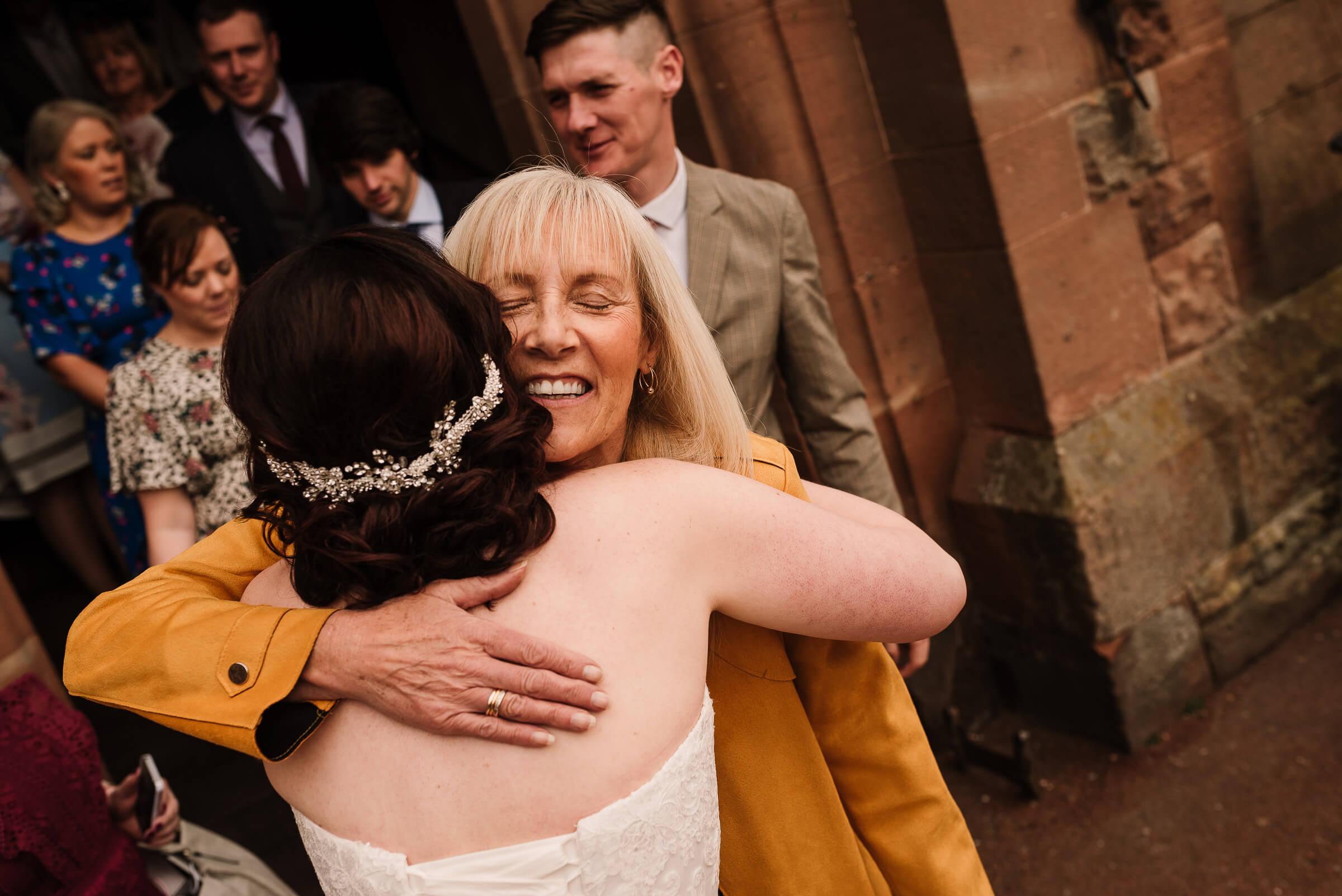 female guest hugging bride