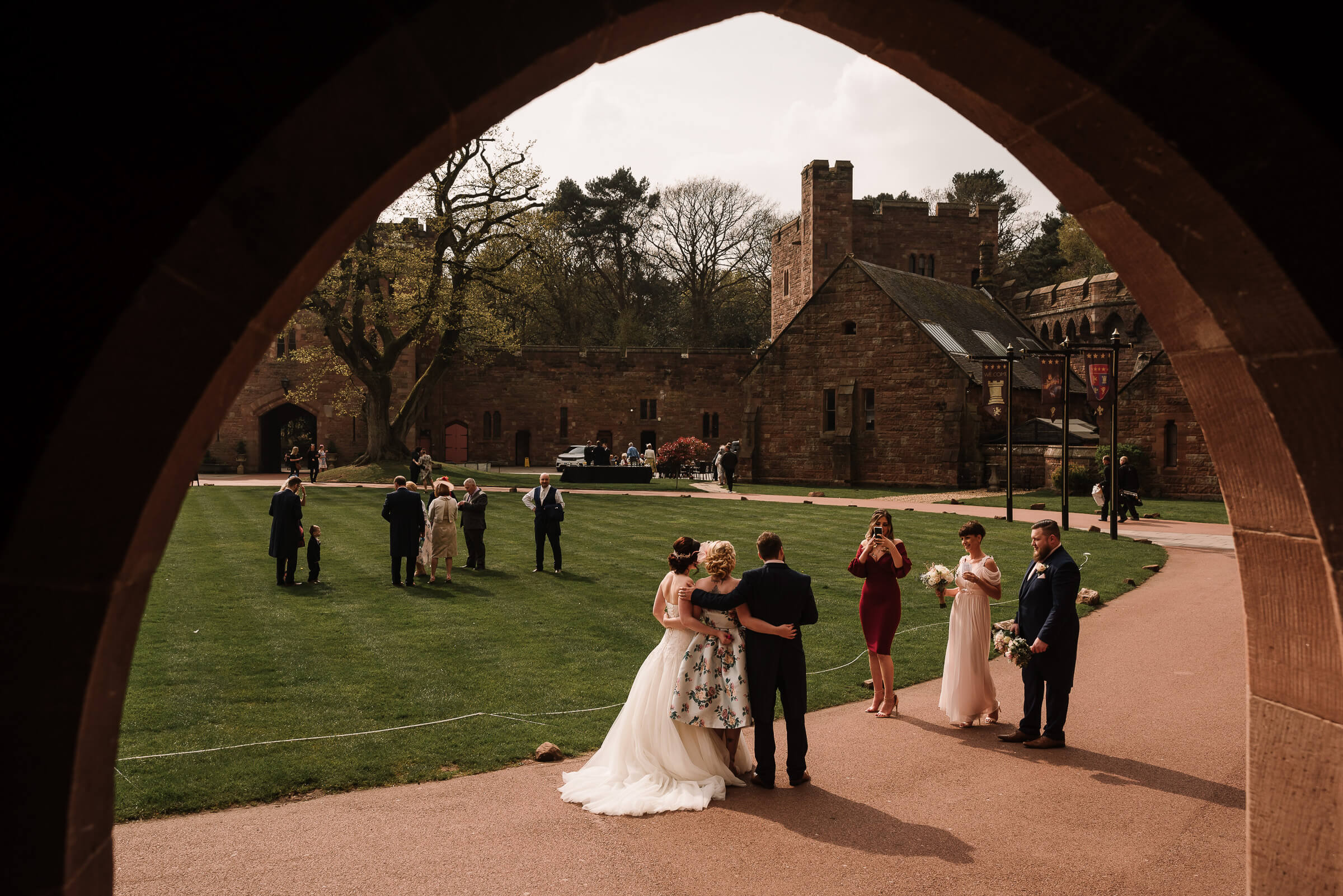 bride and guests framed by arched doorway