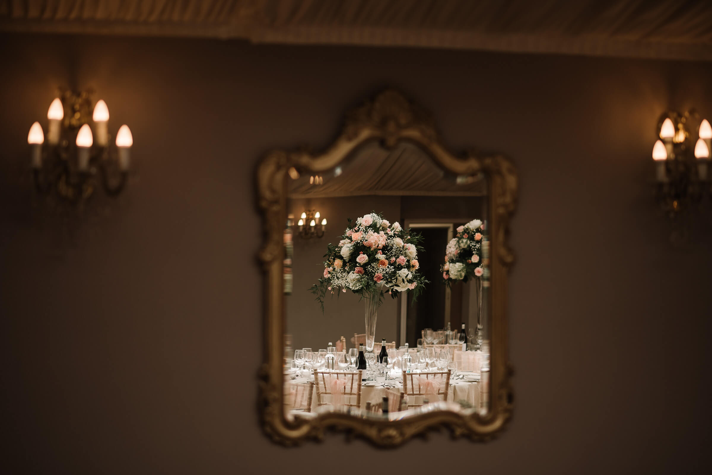 refection of table flowers in mirror