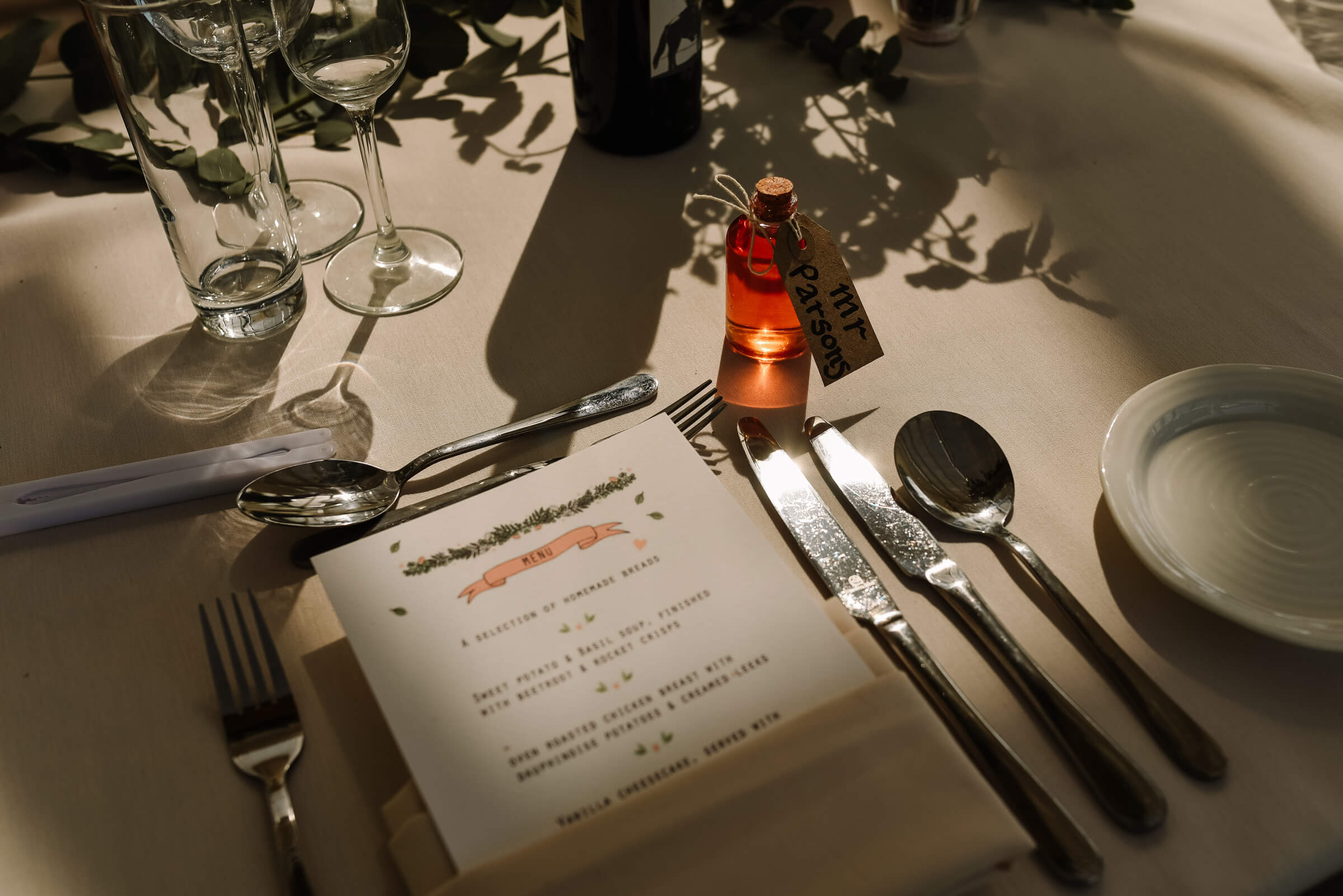 menu and alcoholic wedding favour on tables