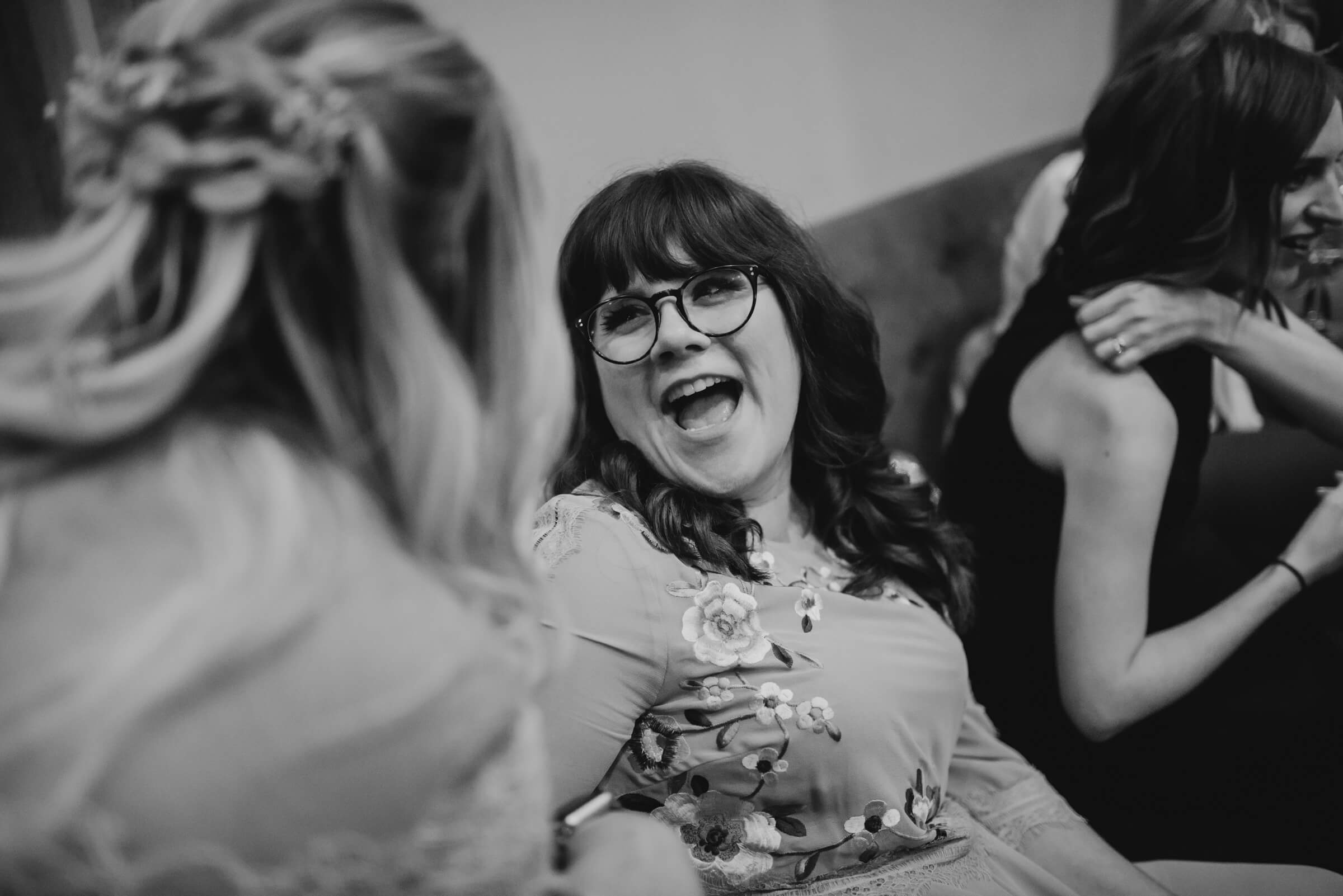 friend of bride smiling and laughing