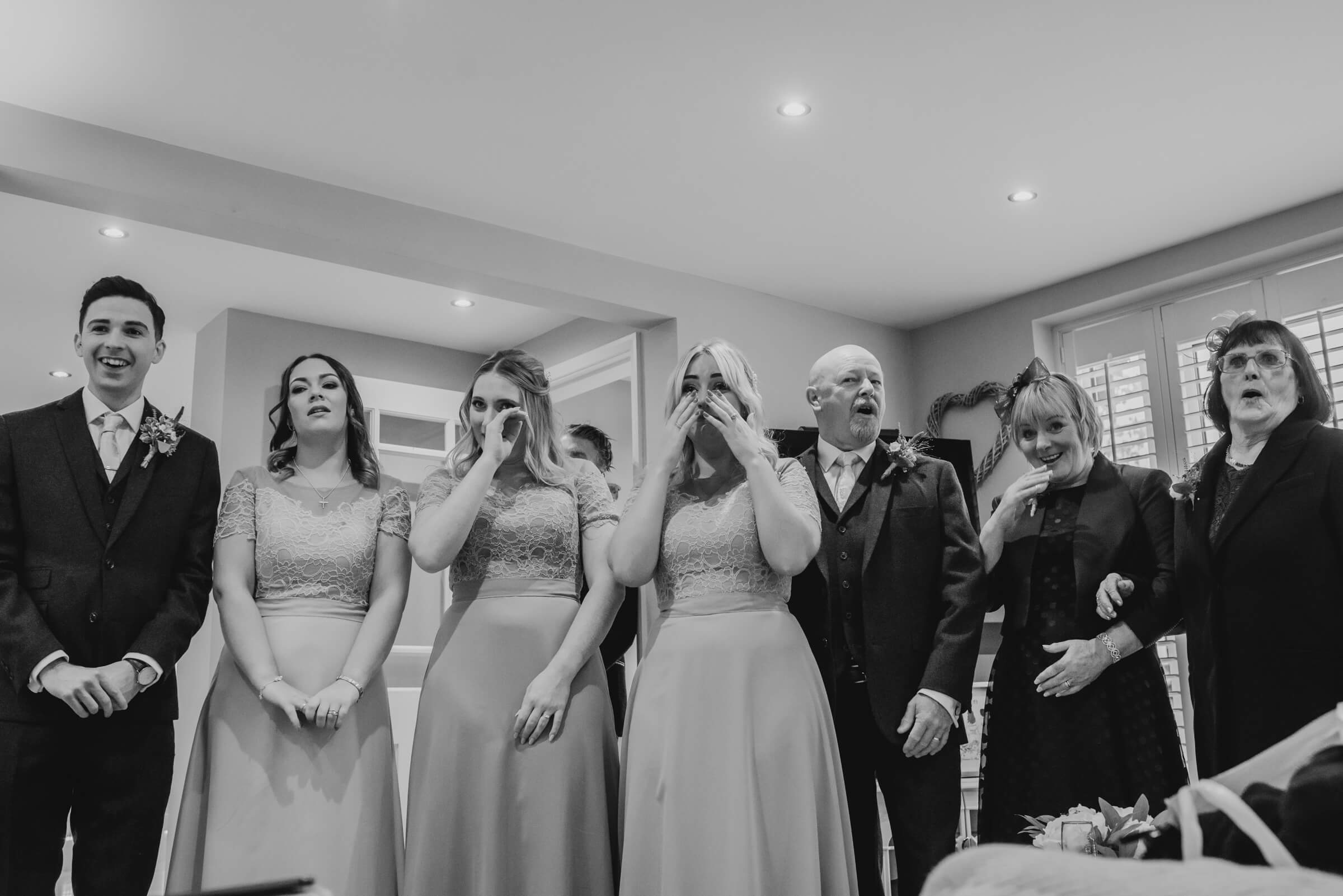 bridal parties reaction to bride in dress