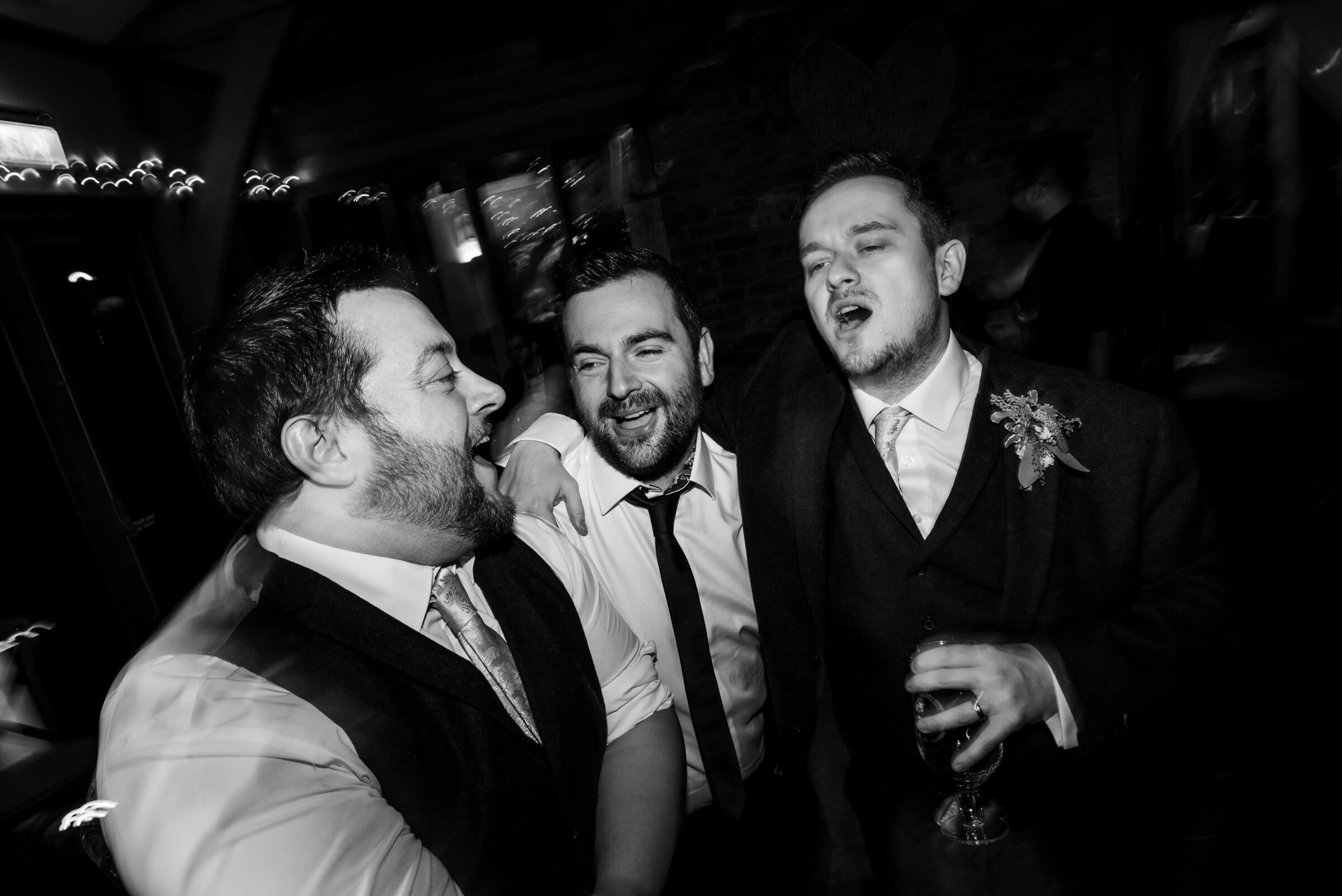 groomsmen singing and dancing