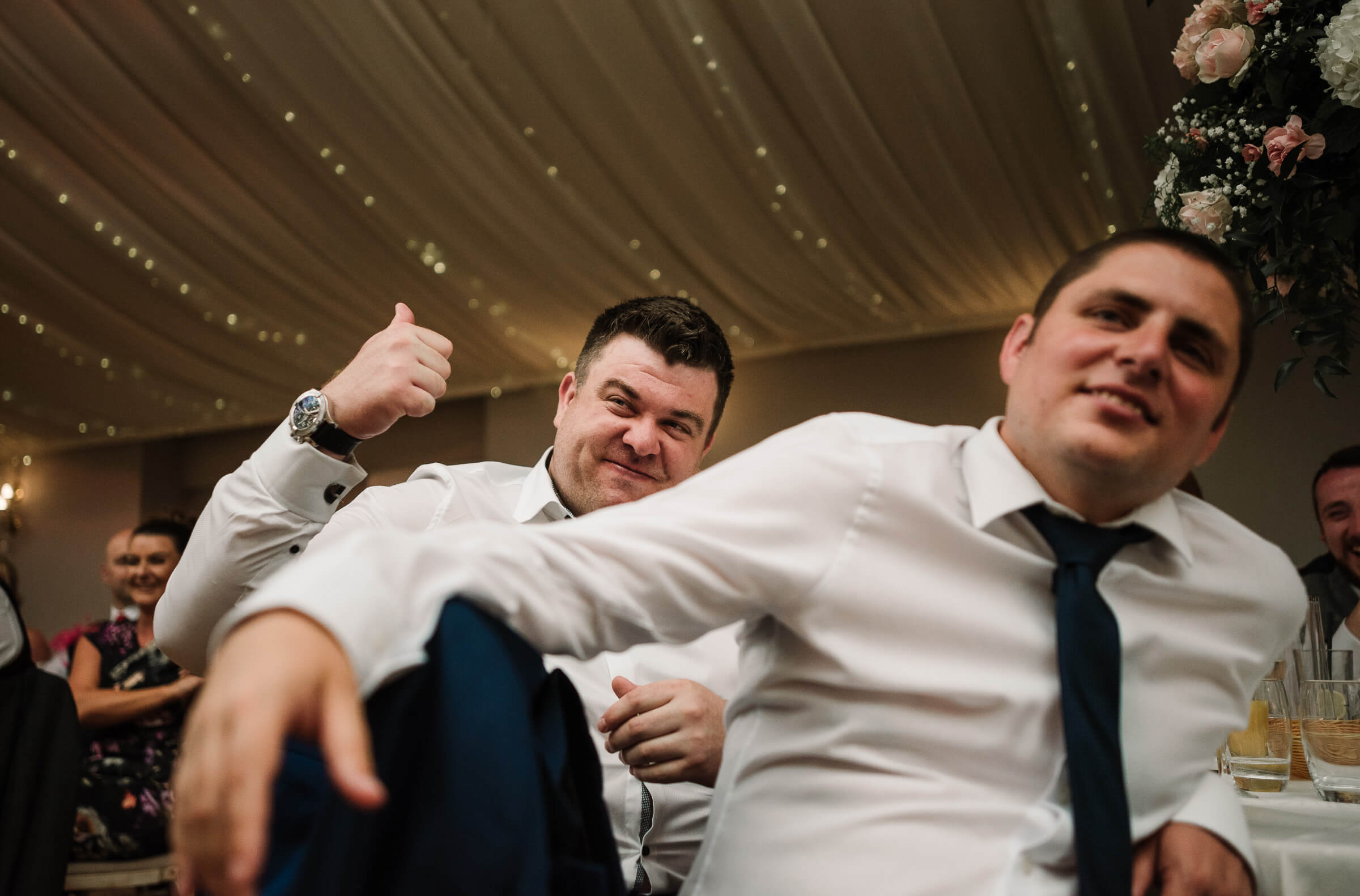 guest giving thumbs up to groom