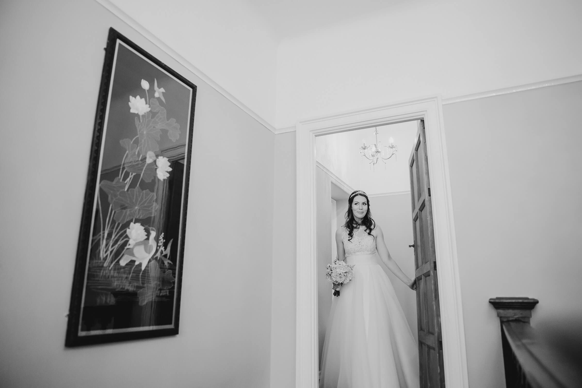 bride leaving room for ceremony