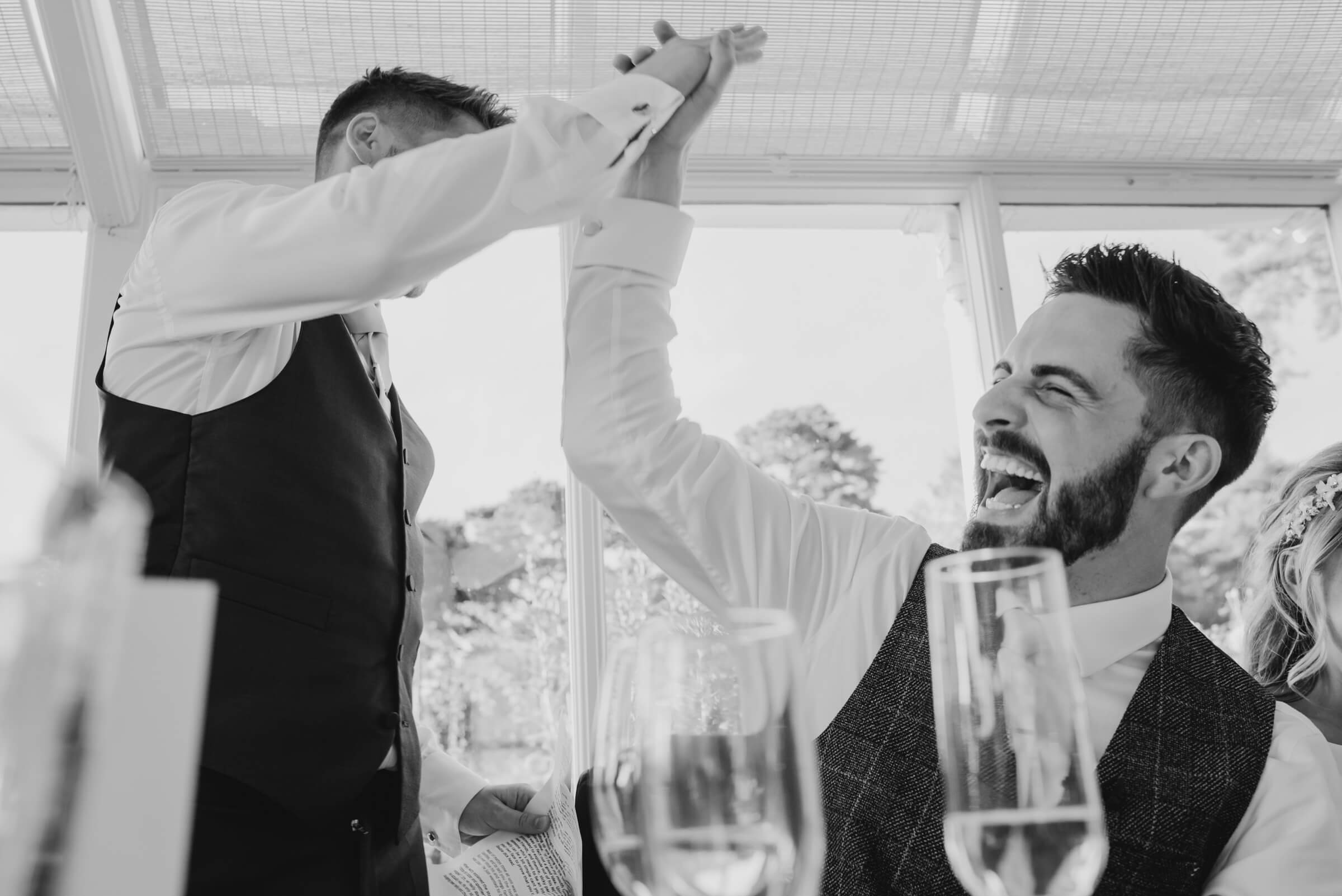 groom and brother high five