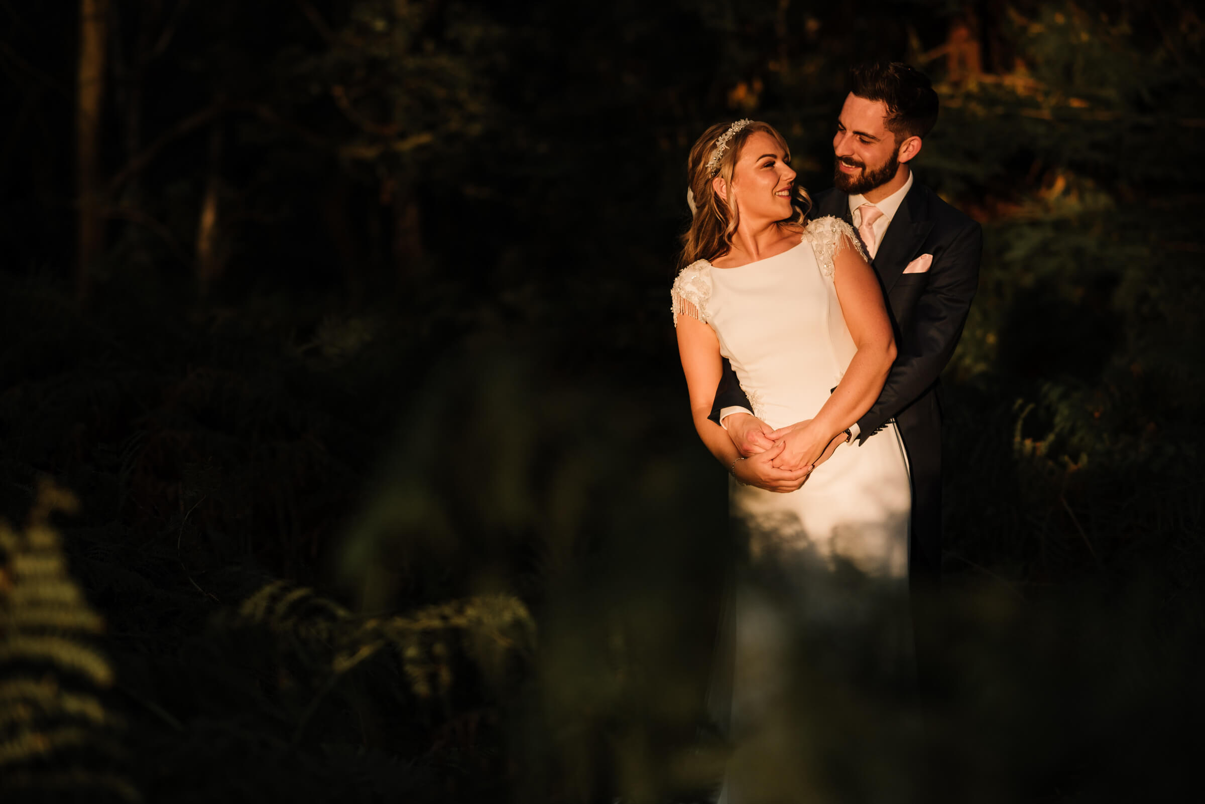bride and groom in forest in golden light