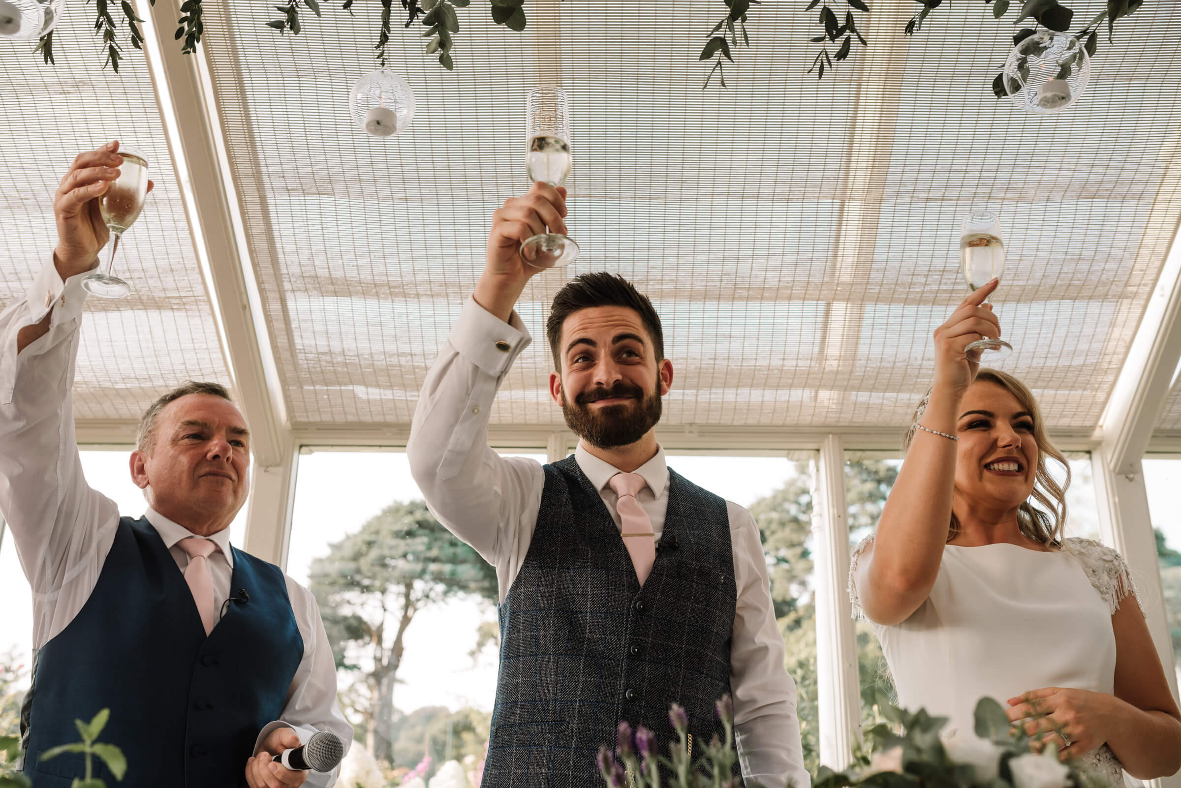 father of bride toasting couple