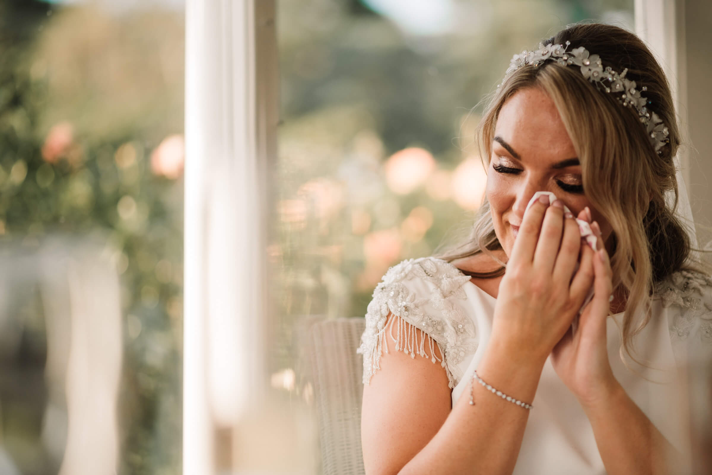 bride wiping away tear during speech