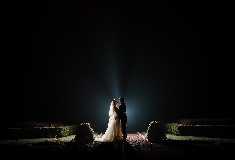 Bride and groom backlit outside