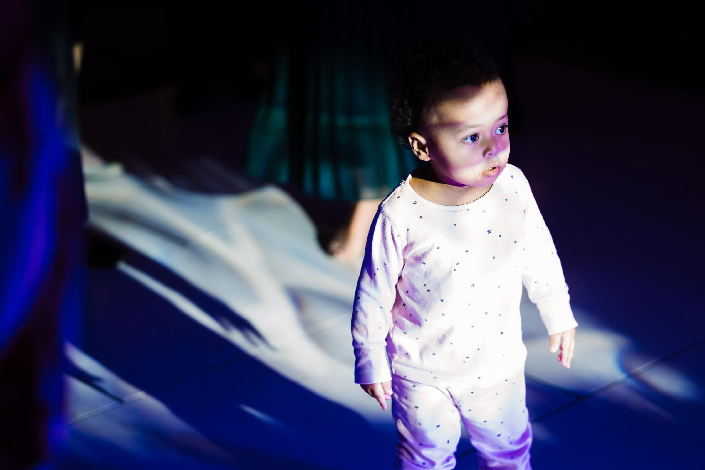 Little girl in pajamas on dance floor