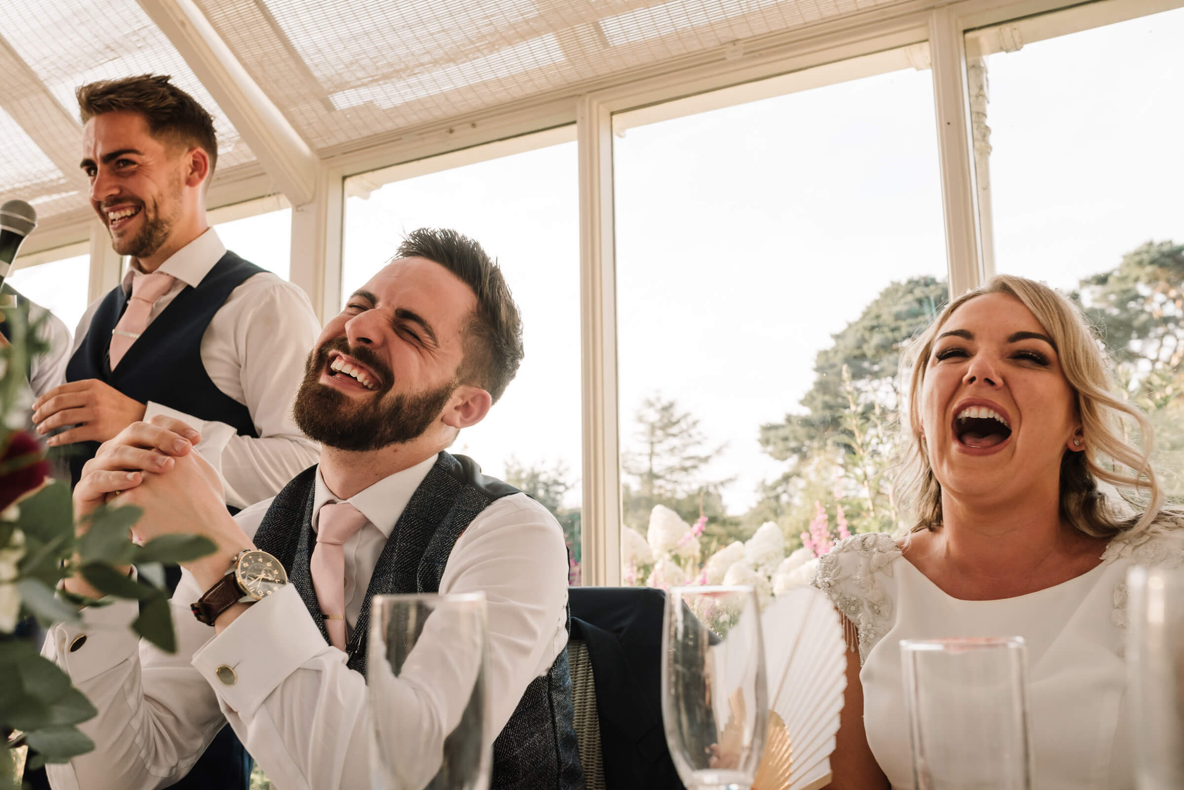 bride and groom laughing at best mens speeches