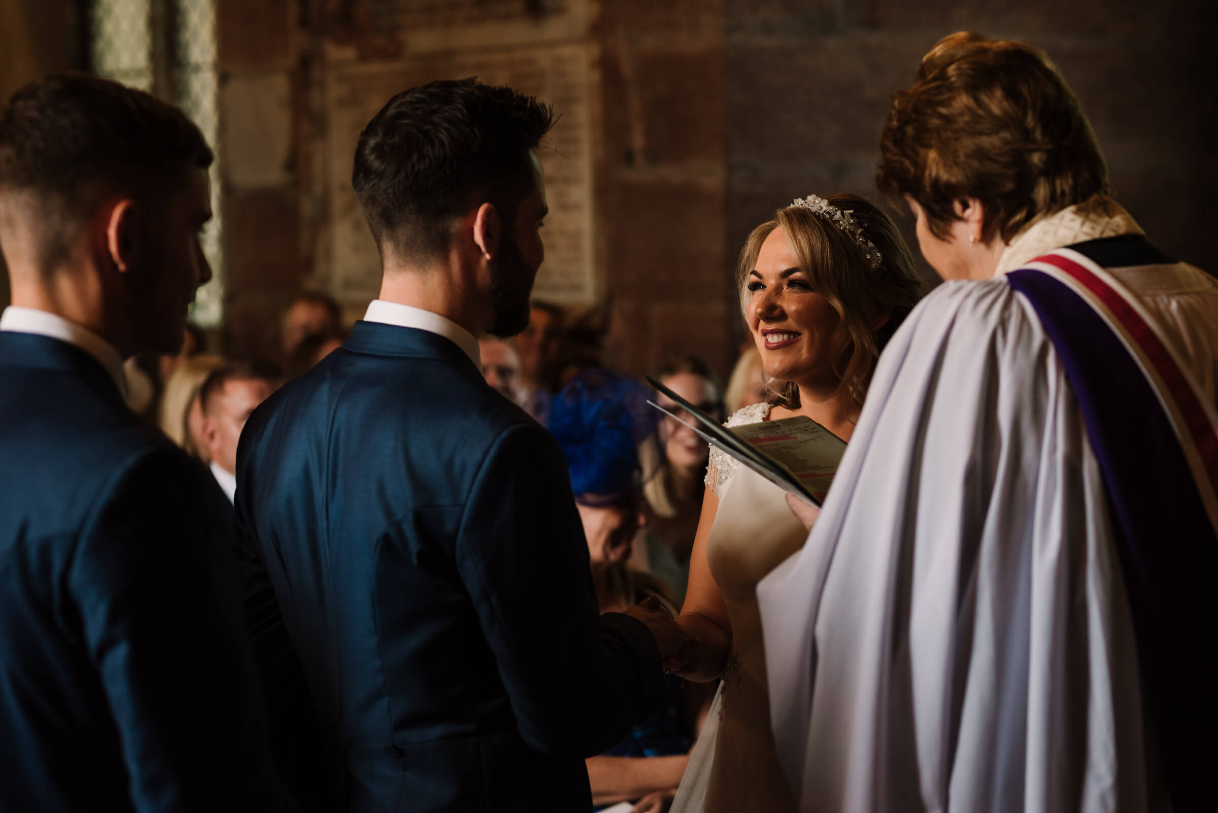 bride smiling at groom and speaking vows