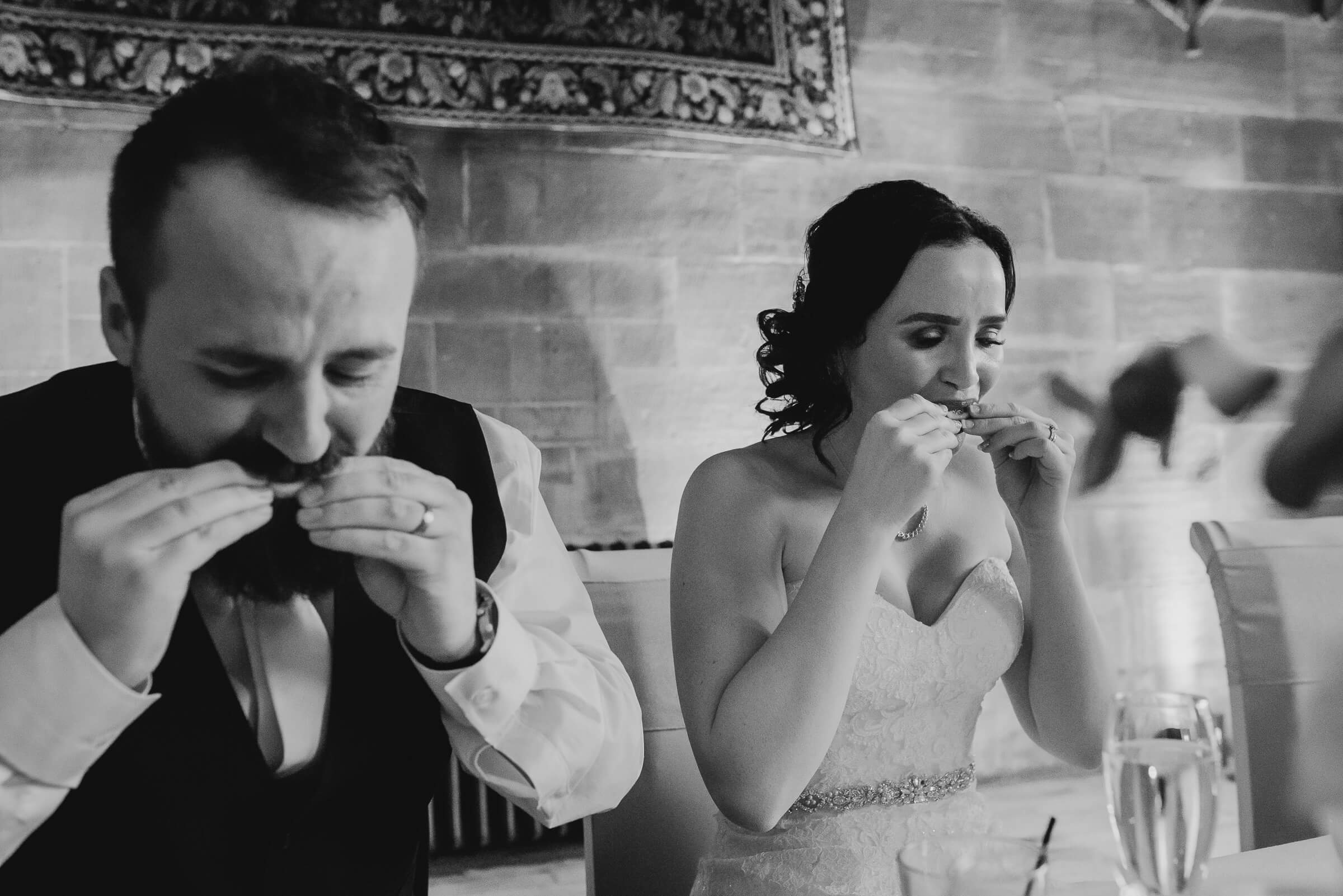 bride and groom having a shot of tequila