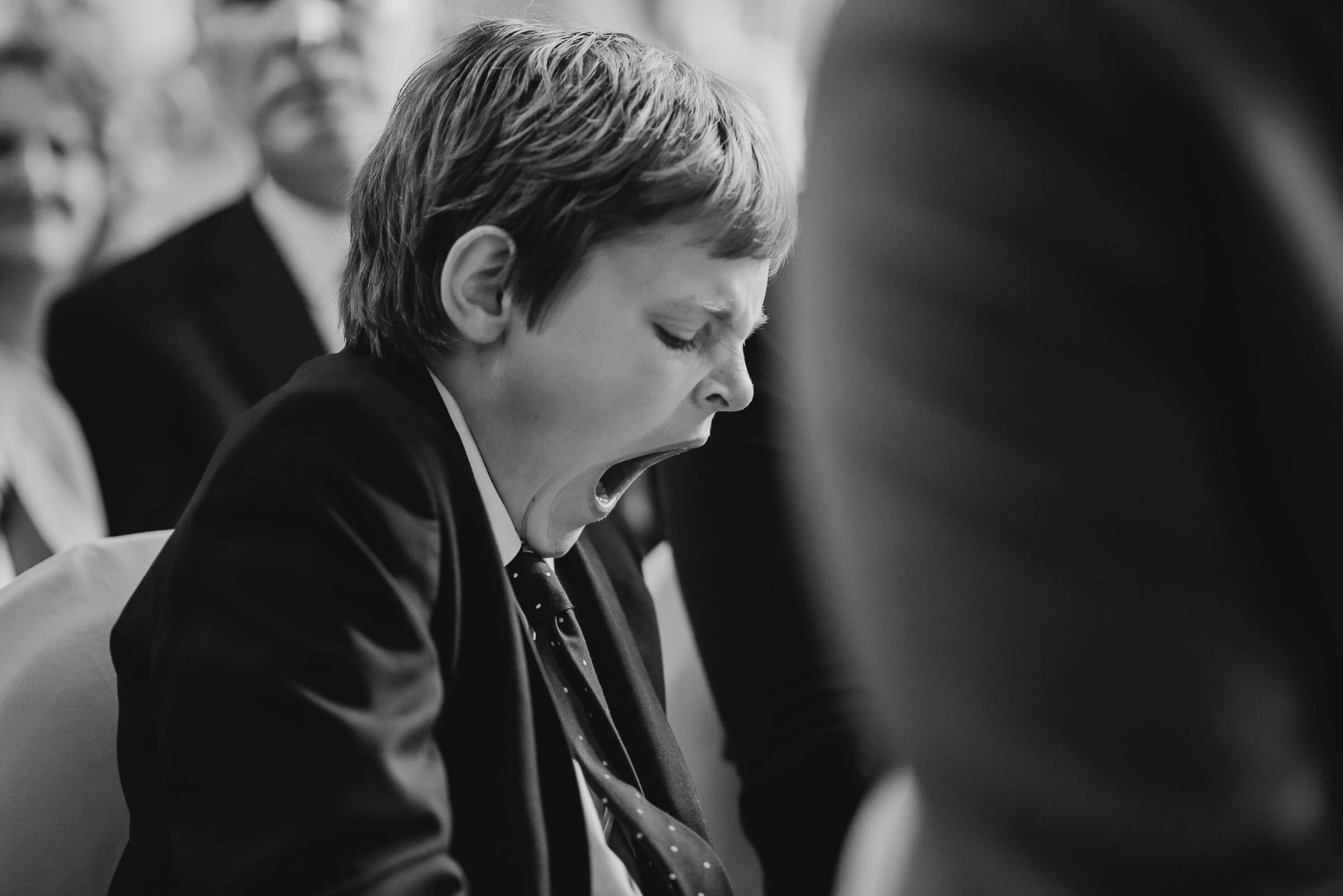 young boy yawning during ceremony