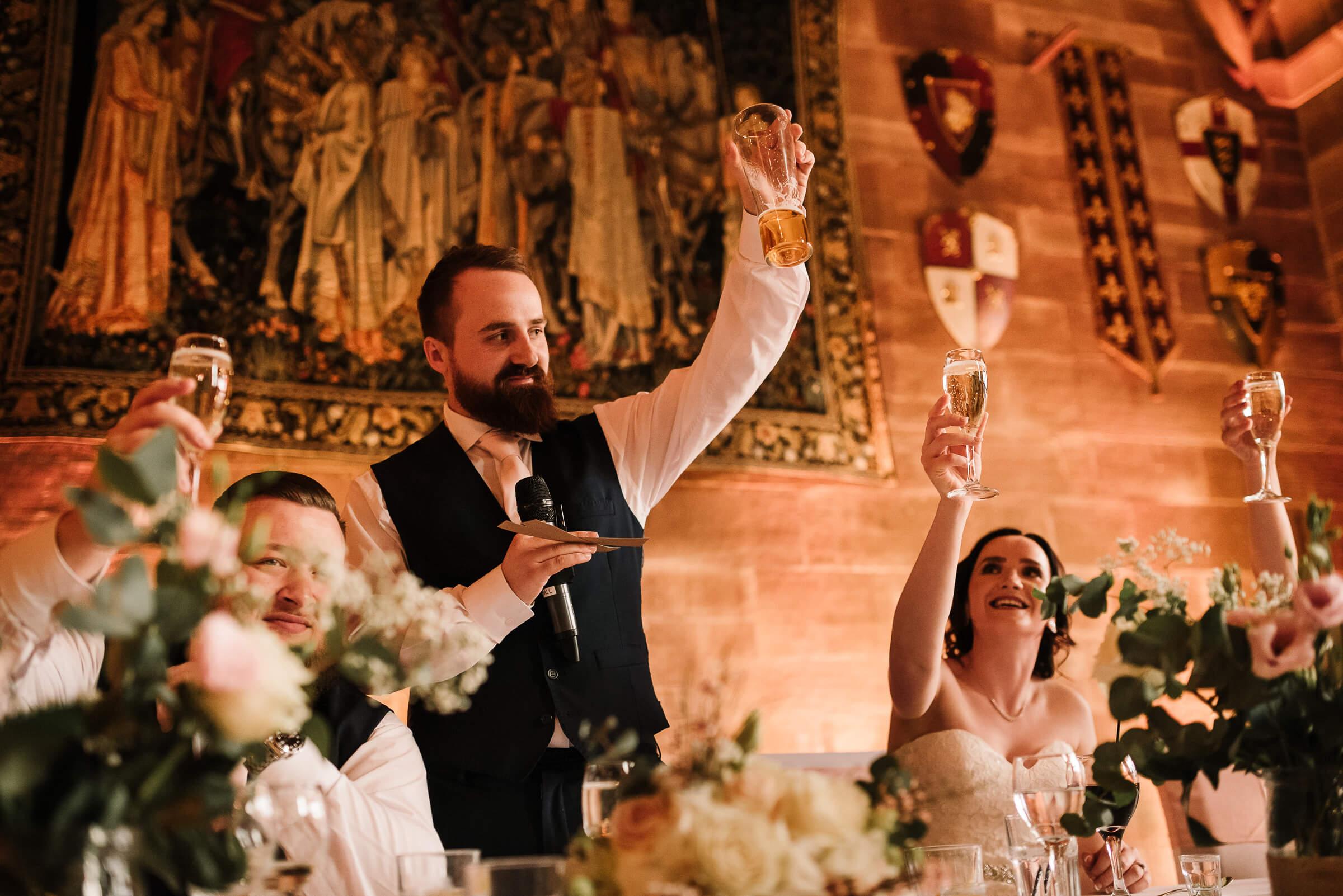 groom raising a toast