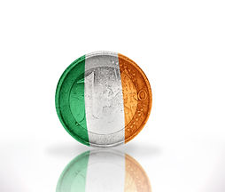euro coin with irish flag on the white b
