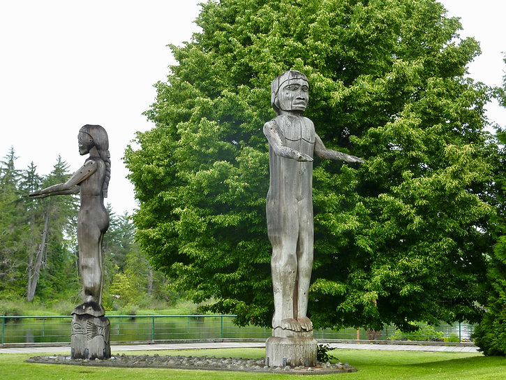 Tseshaht First Nation carved poles | Victoria Quay Park in Port Alberni | cycle touring Vancouver Island
