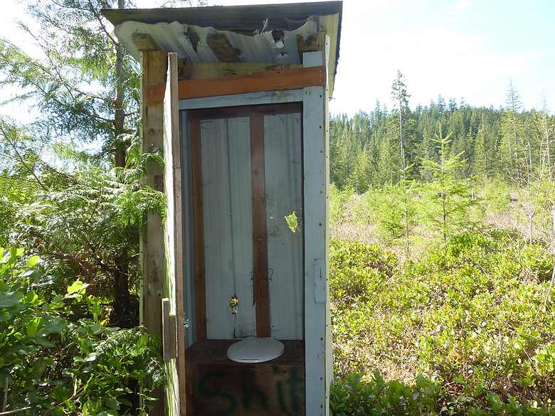 Quinsam Lake, SW of Campbell River, unnerving to see the back of an outhouse used for target practice
