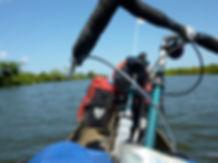 Cycle touring NE Madagascar | Jeff Bock touring bike | river crossing in canoe