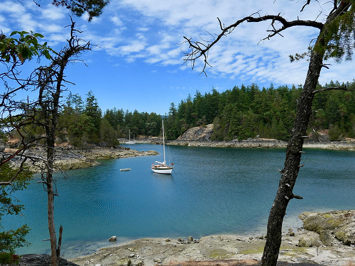 Sailboats moored in Smuggler Cove | fav campground | cycle touring Sunshine Coast