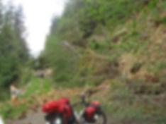 Slide blocking backroad, bikepacking on Walbran Main, near Nitinat Lake