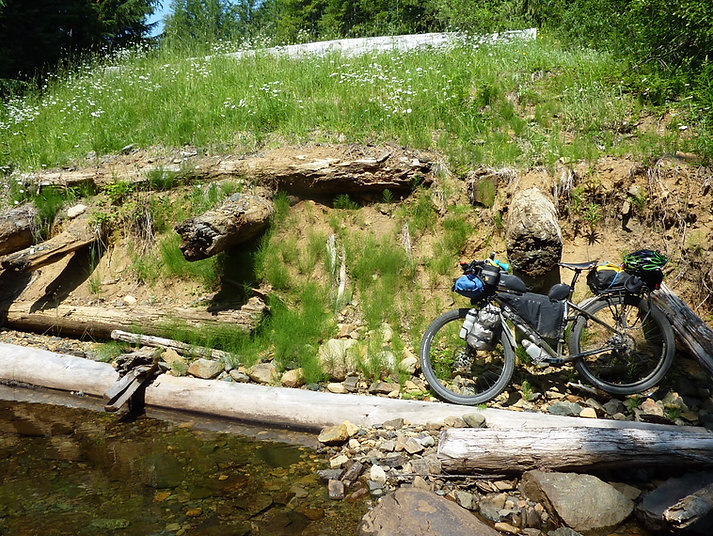Portaging decommissioned bridge | bikepacking Surly ECR