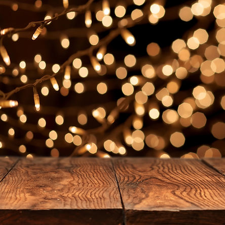Wood table or floor with twinkling lights in the background