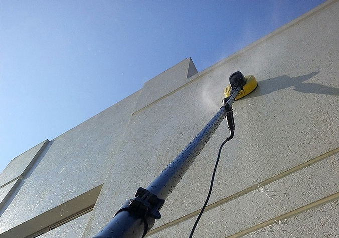 Telescopic Pole with pressure washer attachment in action 7 meter high_edited.jpg