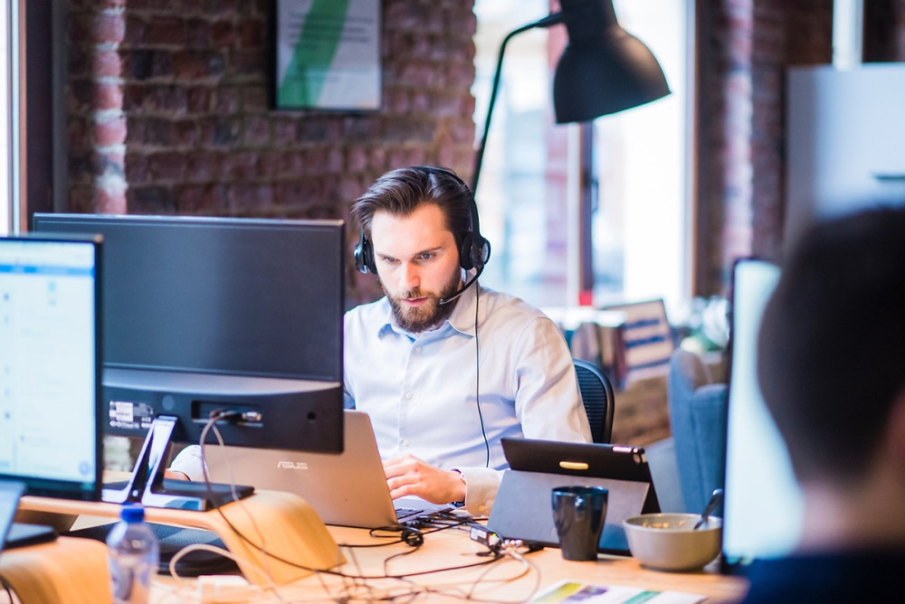 Man with headset in call centre