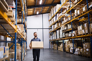 male-warehouse-worker-with-a-large-box-P