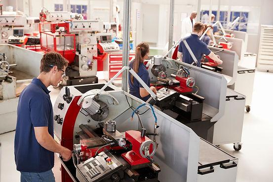 trainee-engineers-operating-equipment-in