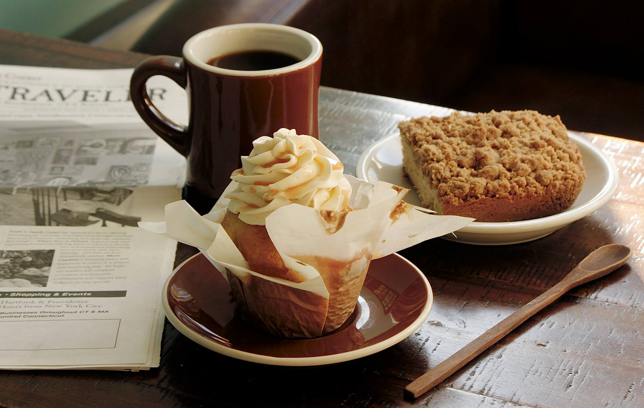 Coffee with cupcake and newspaper