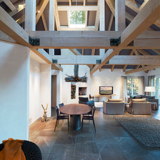Modern Living Area with Arches, Beams &