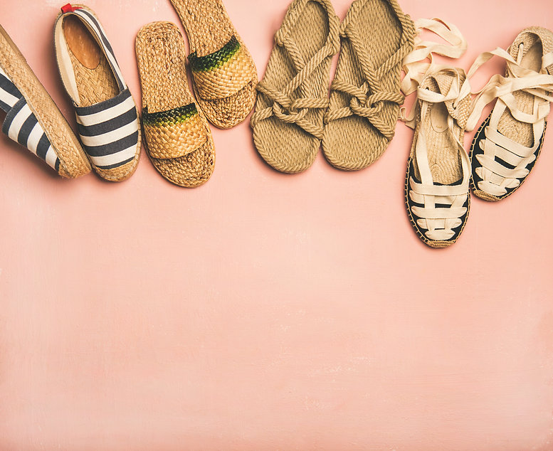 Variety of trendy woman's summer shoes.