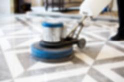 man polishing marble floor in modern off