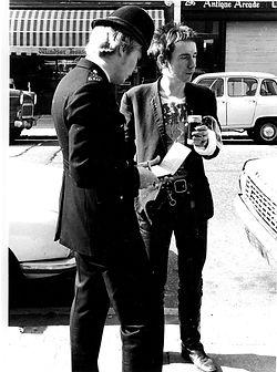 Barry Plummer Photographer Rock Music Photos Johnny Rotten and Policman