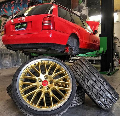 riparazione carrozzeria nuova audi, rossa con cerchi oro, fano