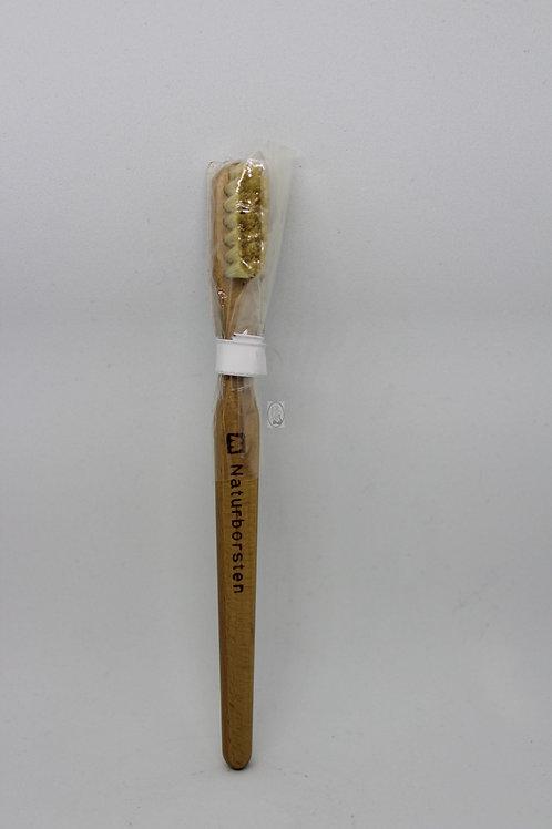 Cepillo de dientes de madera para niños.