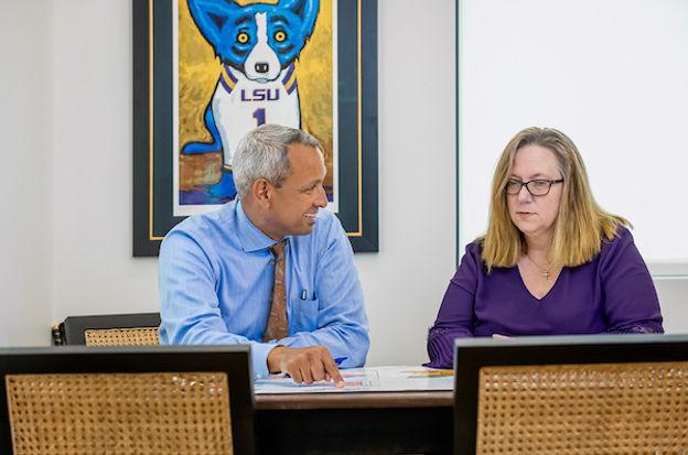 Mr. Franklin and Mrs. Mueller on a workshop meeting