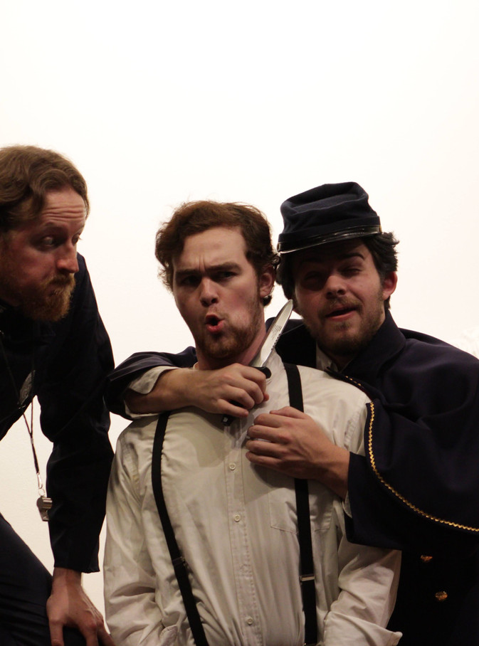 Thomas Bell as Dogberry, Zach Fair as Borachio, Vincent Sadler as Verges, and Mark Foreman as the Sexton
