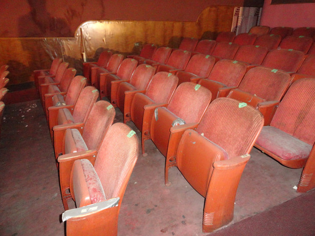 Worn out seats in performance hall