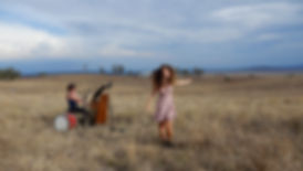 Grace and Hugh with their little upright piano in the middle of The Liverpool Plains NSW