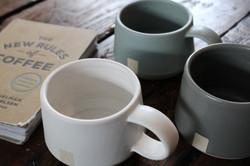 mugs in coffee shop