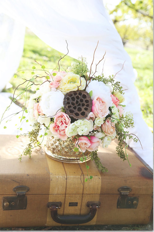 Faux bohemian peonies and lotus pod centerpiece