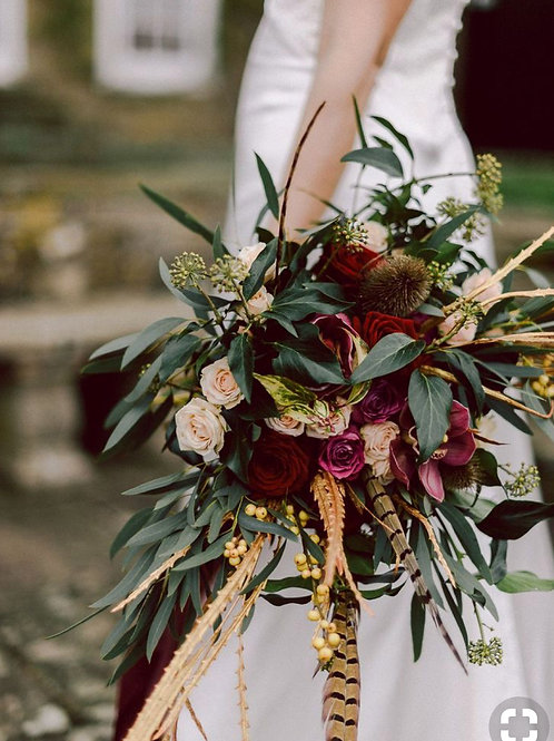 Tara's large faux bridal bouquet with peasant feathers