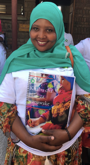 Husna, our community legal advisor is surprised to see herself on the front of our training manual.