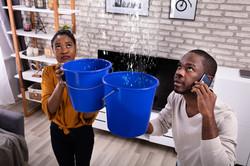 Pipe Water Leak - Couple Using Bucket