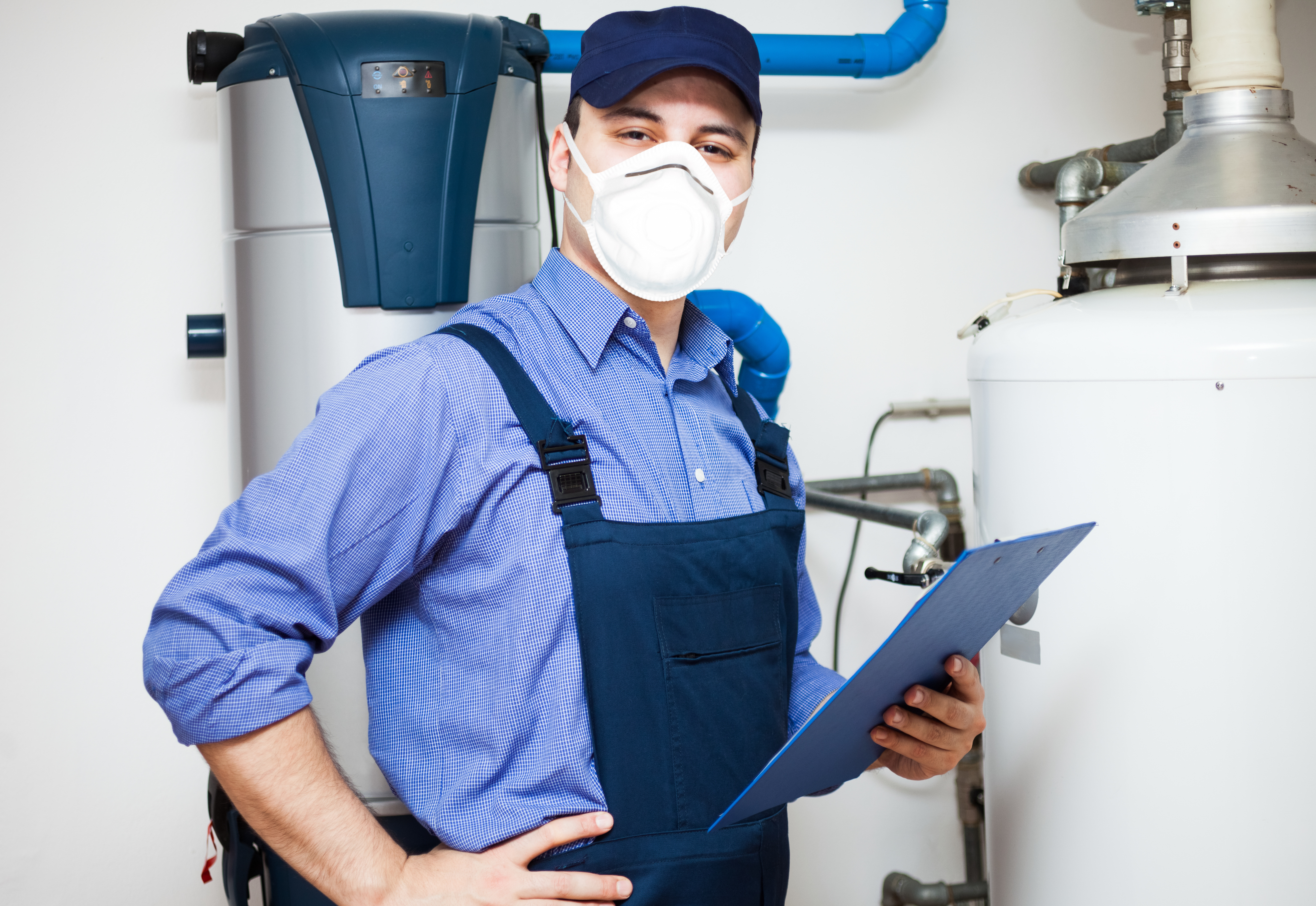 technician servicing hot water heater